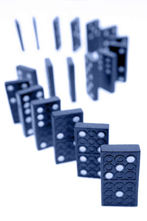 upright row: Dominoes standing on plain background