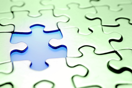 Piece missing from jigsaw puzzle  Stock Photo - 8266135