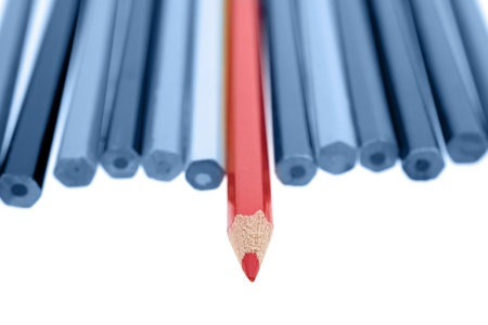 odd: One red pencil standing out from dull pencils Stock Photo