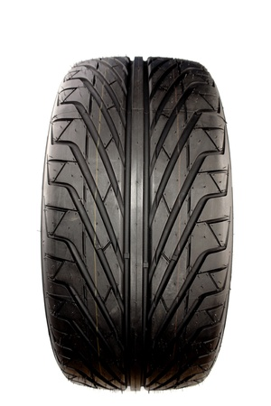 Auto tyre isolated on plain background   photo