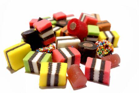 Licorice sweets on plain background