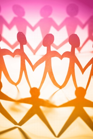 Crowd of colorful people holding hands   photo