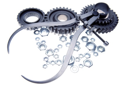 Calipers, nuts and cogwheels on plain background   photo