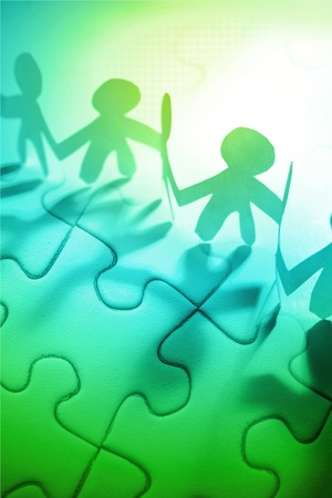 joining together: Group of people and jigsaw puzzle pieces