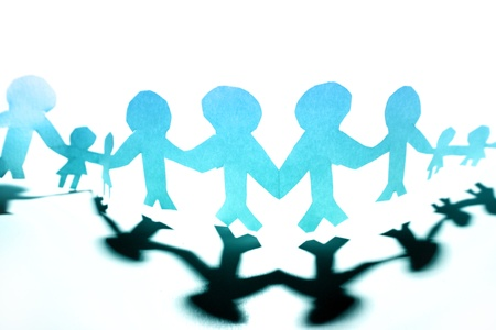 Paper doll people holding hands photo