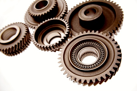 Closeup of metal gears on white   photo