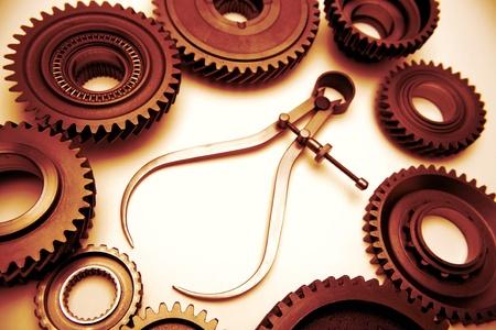 pr�cis: Compas et roues dent�es. Studio abattu   Banque d'images