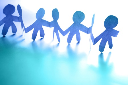 Paper doll people holding hands Stock Photo - 8672353