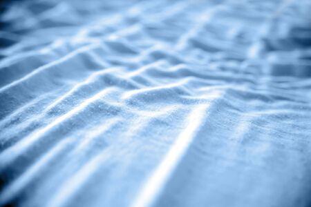 bedsheets: Closeup of crumpled blue fabric