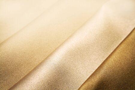 Closeup of folded brown silk fabric  photo