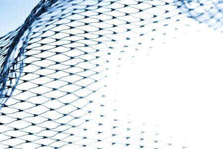 Closeup of netting on white background photo