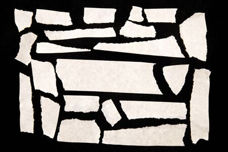 Pieces of torn paper on black Stock Photo - 8752925