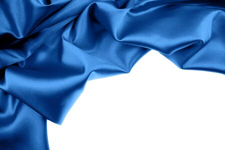 Blue silk fabric on white background. Copy space   photo