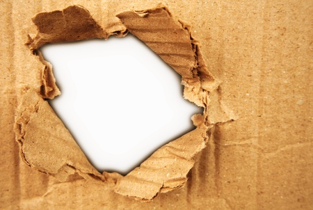 rips: Hole ripped in corrugated cardboard   Stock Photo