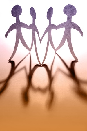 Paper doll people holding hands Stock Photo - 9005699