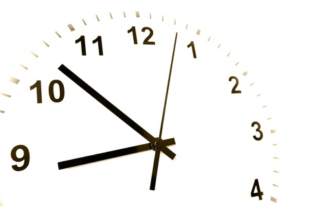 Hands of clock pointing to nine o'clock Stock Photo - 9005717