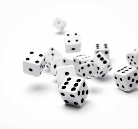 Dice rolling on plain background Stock Photo - 9441892