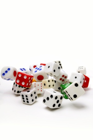 Dice rolling on plain background Stock Photo - 9508078