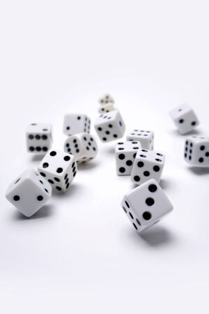 Dice rolling on plain background Stock Photo - 9508113