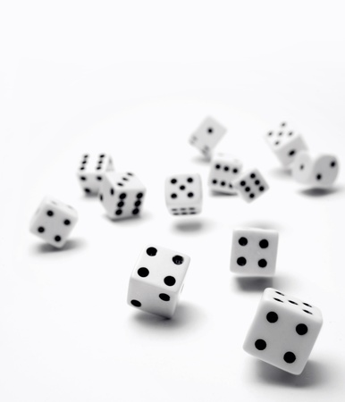 Dice rolling on plain background Stock Photo - 9508126