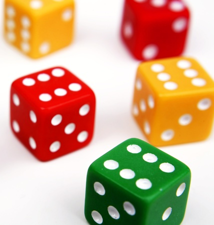 Colorful dice on plain background Stock Photo - 9508129