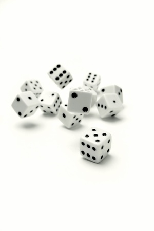 Dice rolling on plain background Stock Photo - 9569903