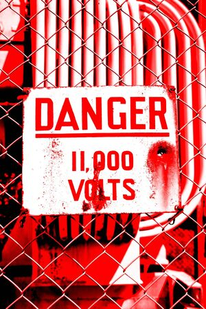 High voltage warning sign on fence Stock Photo - 9569938
