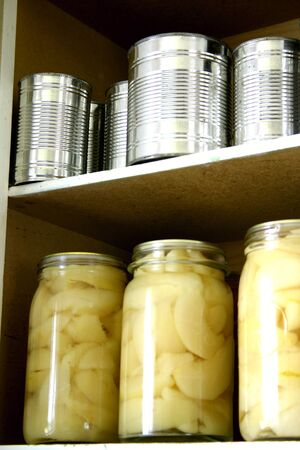 Bottled fruit and cans on shelf Stock Photo - 9570301