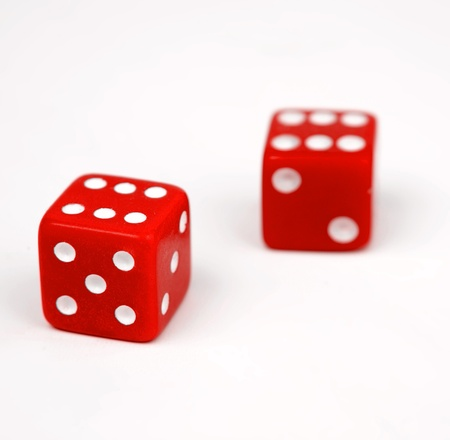 Two red dice isolated on white background Stock Photo - 9570179