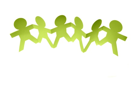 Group of people holding hands on plain background Stock Photo - 9570331