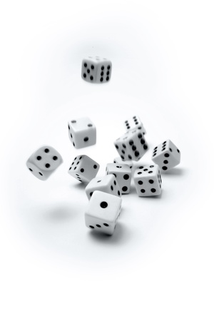 Dice rolling on plain background Stock Photo - 9570341