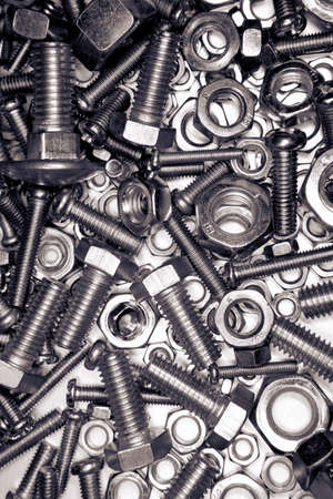 Closeup of metal nuts and bolts photo