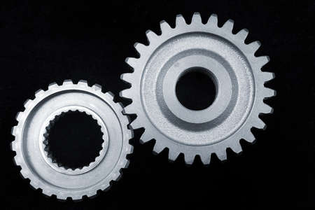 Two gears meshing together Stock Photo - 9788521