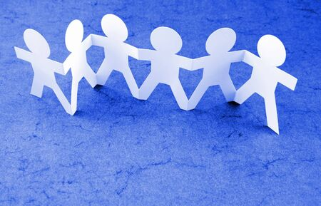Group of people holding hands photo