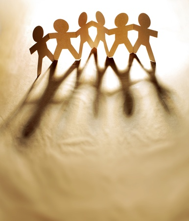 co operation: Group of people holding hands