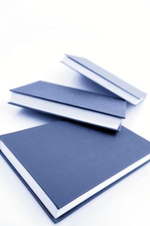 manuals: Textbooks on plain background