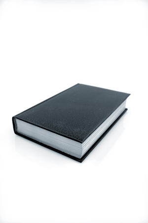 hardback: Textbook on plain background Stock Photo