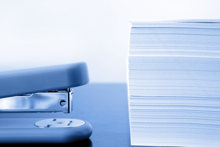 Stapler next to pile of papers Stock Photo - 10026316