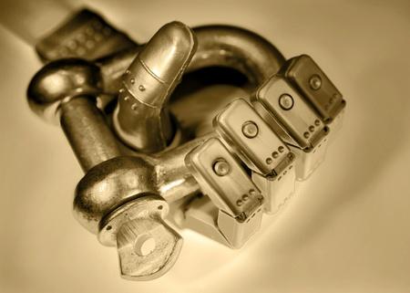 shackle: Robot hand holding metal shackle