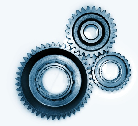 Three gears meshing together photo