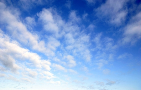 daytime: White fluffy clouds in blue sky