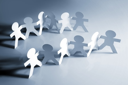 cooperating: Teams of people holding hands Stock Photo