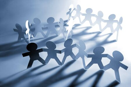 mankind: Teams of people holding hands Stock Photo