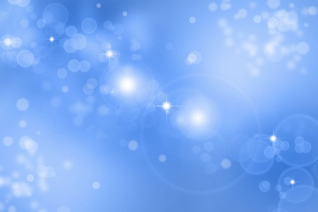Stars sparkling on blue background photo