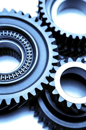 three wheel: Closeup of three steel cogwheels Stock Photo