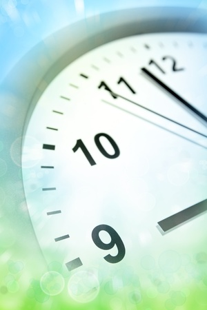 oclock: Closeup of clock face pointing to nine oclock Stock Photo