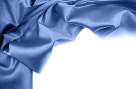 Blue silk material on white background. Copy space photo