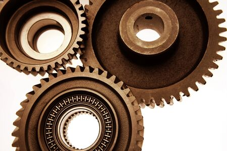 cogwheels: Closeup of three steel cogs Stock Photo