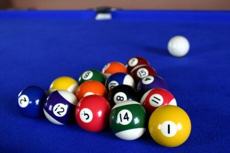 Pool Balls On Blue Pool Table Photo