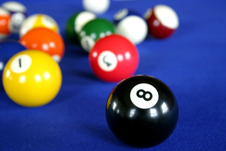 color balls: Pool balls on blue pool table Stock Photo